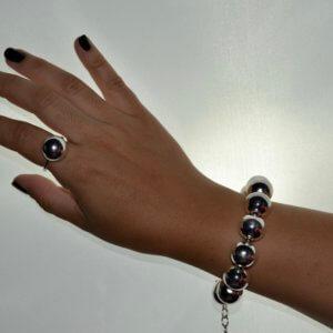 conjunto de pulsera y anillo de bolas plaeadas